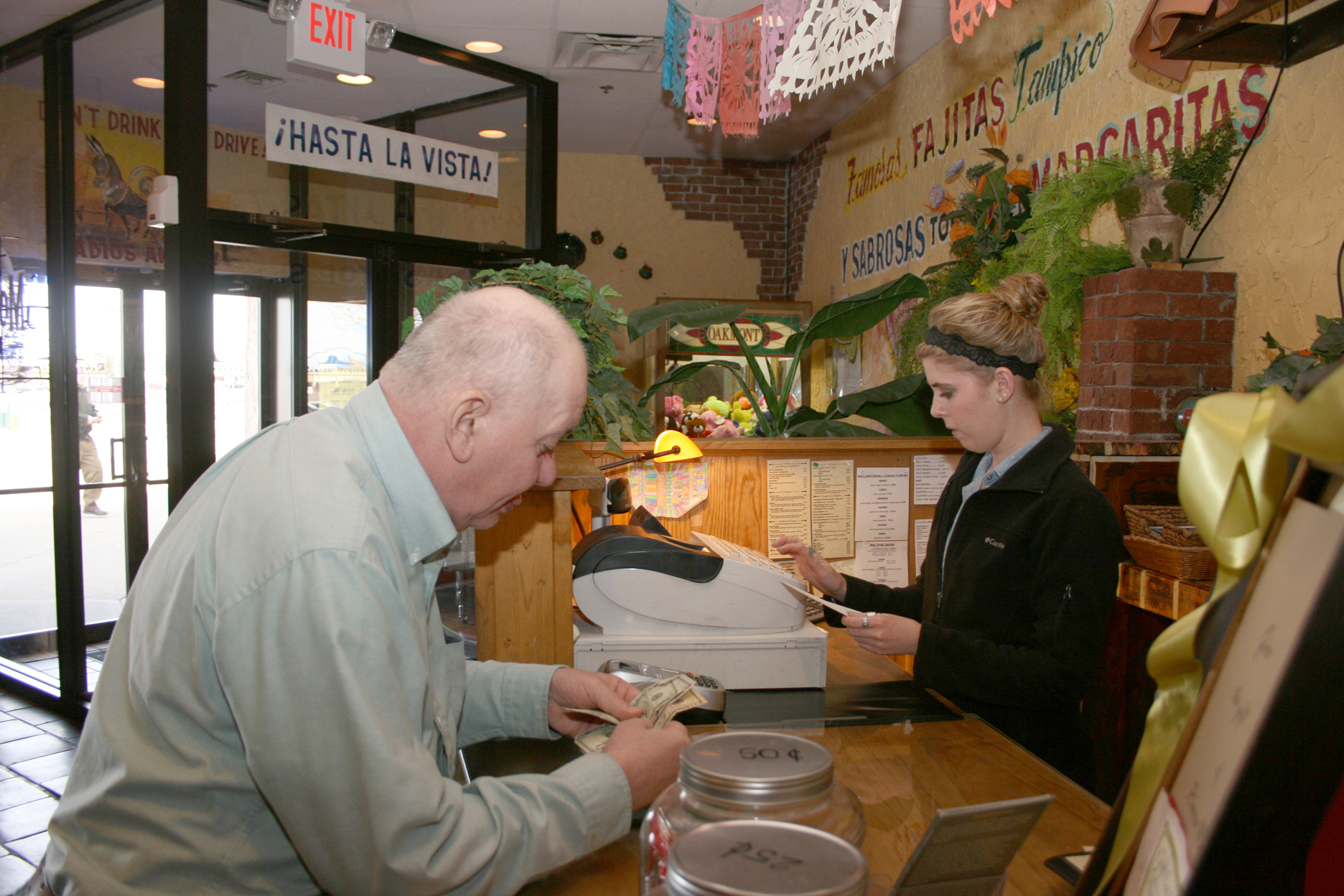 Marty Rains of Bethel chats with the hostess at Rincon Mexicano Restaurant in Eastgate.  Rains and other individuals from CCDD had dinner at Rincon after one of their PRIME training classes, in an effort to use skills they learned in class to promote independence while practicing employment skills.